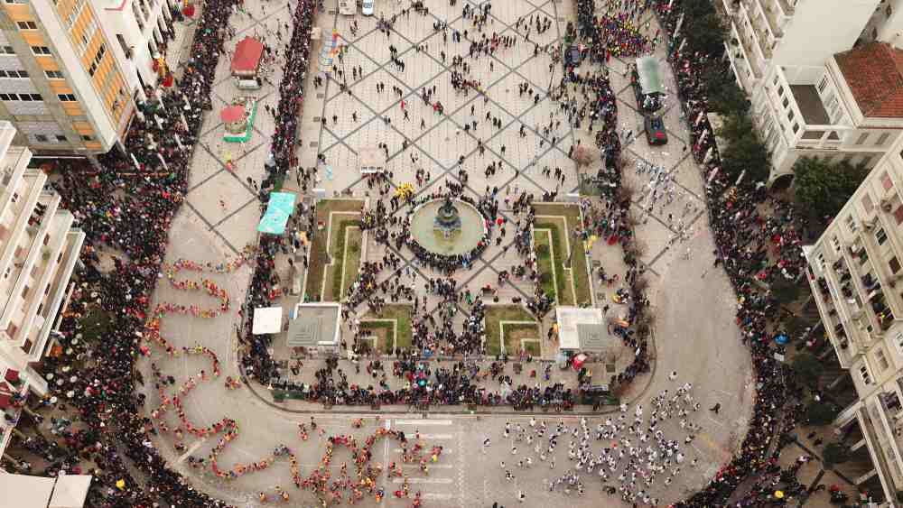 Greece - Patra Aerial drone photo of iconic fully crowded square of Saint George or Agios Georgios during the annual Carnival Parade in city of Patras, Achaia, Peloponnese, Greece