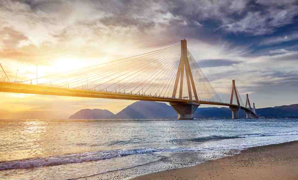 Greece - Patra - Sunset view on the bridge near Patras. Suspension bridge crossing Corinth Gulf strait, Greece, Europe. Second longest cable-stayed bridge in the world. Dramatic red sky under a Rion-Antirion Bridge.