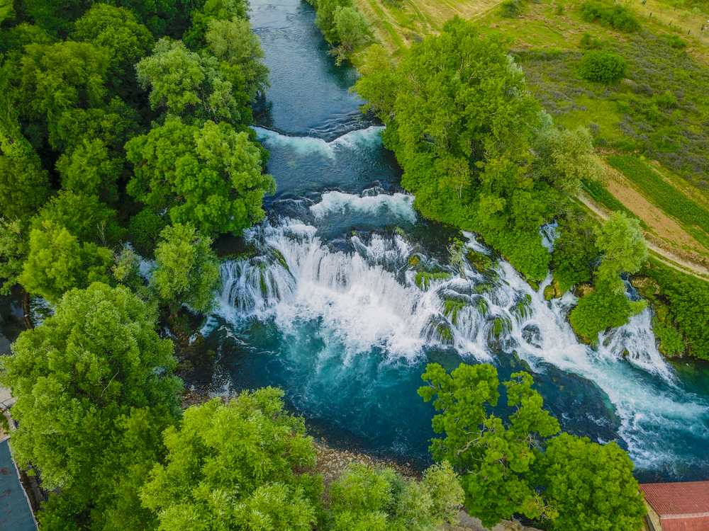 Bosnia - Koćuša Waterfall is situated in southern Bosnia and Herzegovina, and it is one of the most beautiful nature pearls in the region. The height of the tufa waterfall is 5 m and the length is 50 m.
