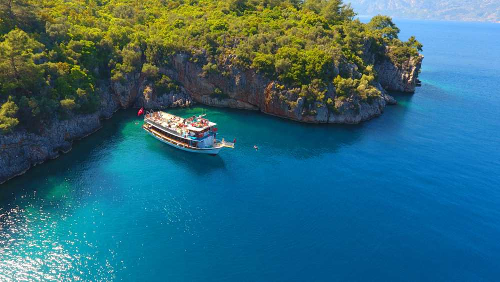 Turkey - Touristic boat trips in the Gokova Bay which is located in Aegean Sea side of Turkey, turquoise sea and aerial view from the top in Marmaris/Mugla