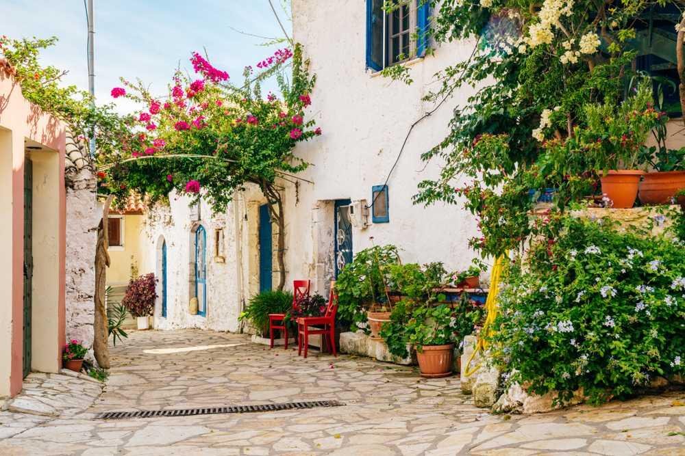 Greece - Crete - Cozy street with rich greenery in Afionas village, Corfu, Greece.