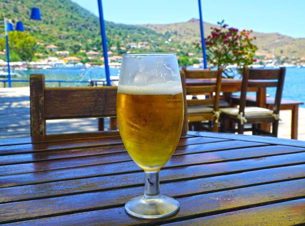 Turkey - Marmaris -  Glass of cold beer in waterfront restaurant in Selimiye, Marmaris, Turkey.