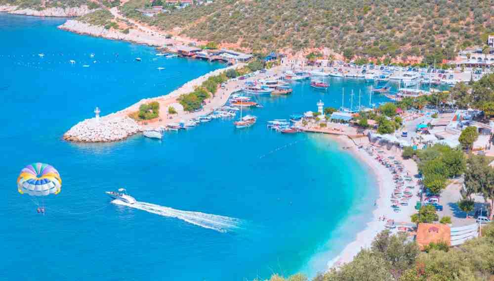 Turkey - Kas - Holidaymakers sunbathing at Kalkan beach - Kalkan, Turkey