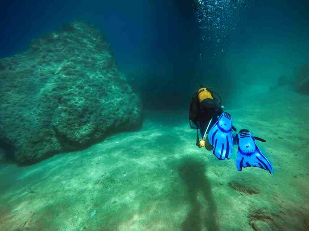 Turkey - Kas - Diver swims near a cave in Alanya / Turkey