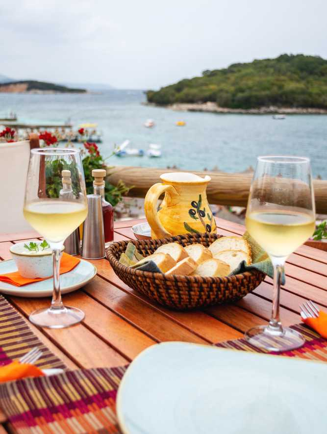 Albania - Ksamil - Restaurant with served table in seafront of Ionian sea, Ksamil