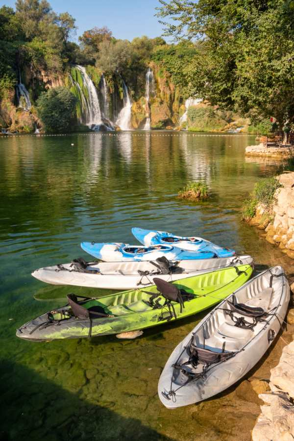 Bosnia and Herzegovina - Kayaks waiting for tourists at Kravica waterfall on Trebizat river in Bosnia and Herzegovina