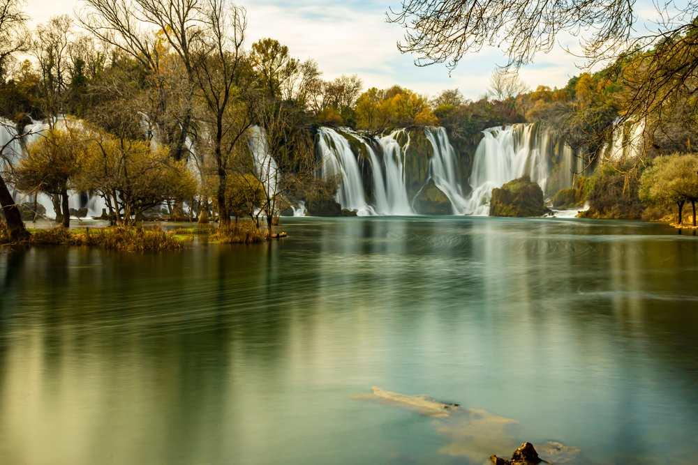 Bosnia and Herzegovina -- Autumn gold Kravice waterfall on the Trebizat River in Bosnia and Herzegovina. Fall Miracle of Nature in Bosnia and Herzegovina. The Kravice waterfalls, originally known as the Kravica waterfalls