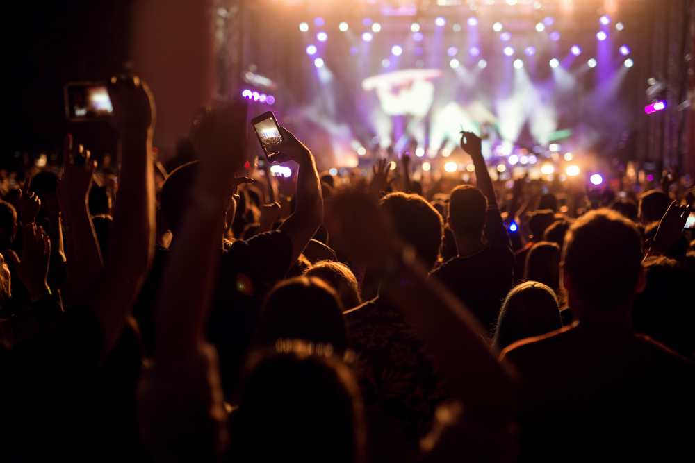 novi sad - exit music festival - People enjoying a concert holding their hands up and recording with their smart phones.