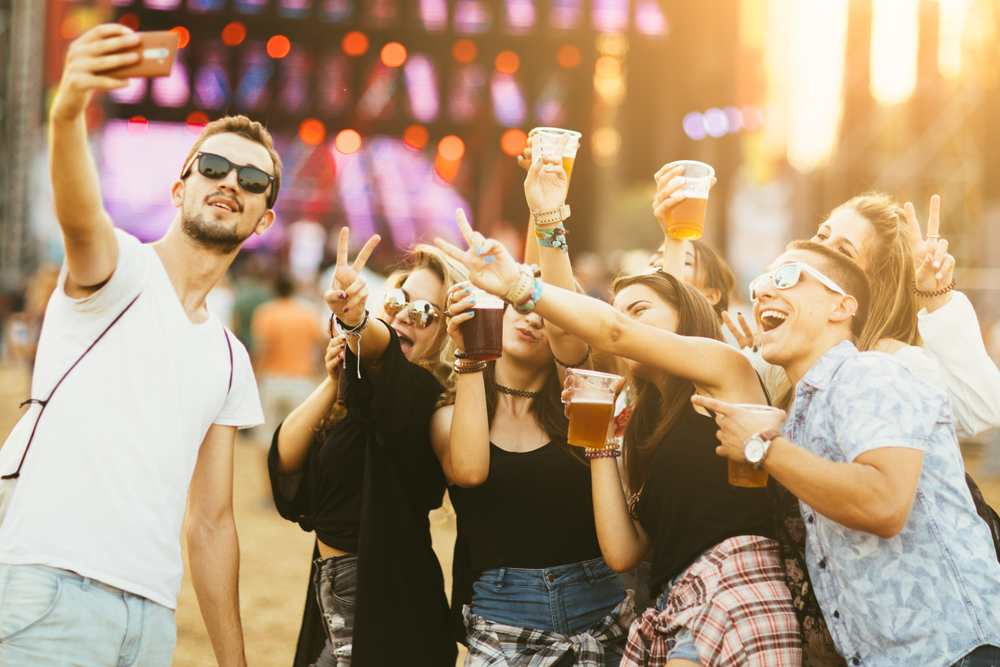Serbia - Friends drinking beer and having fun at music festival